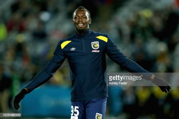 Usain Bolt warms up before the game during the pre-season match between the Central Coast Mariners and Central Coast Football at Central Coast...