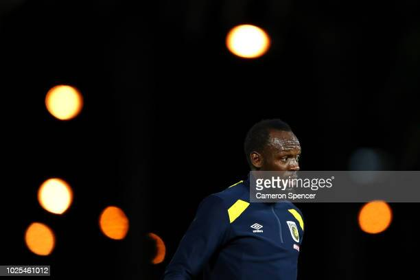 Usain Bolt warms up during the preseason match between the Central Coast Mariners and Central Coast Football at Central Coast Stadium on August 31...
