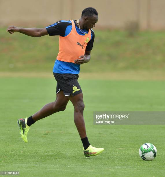 Usain Bolt with Sundowns players during the Usain Bolt Visit to Mamelodi Sundowns Training Session at Chloorkop on January 29, 2018 in Pretoria,...