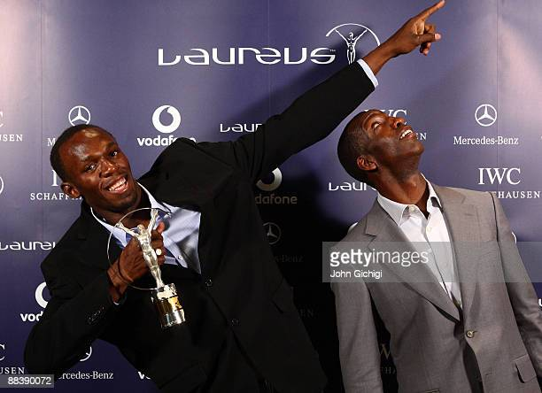 Usain Bolt World record holder for 100m and 200m poses with Academy Member Michael Johnson after receiving the Laureus World Sportsman of the year...
