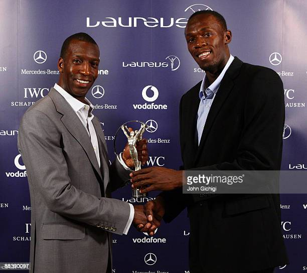 Usain Bolt world record holder for 100m and 200m receives the Laureus World Sportsman of the year award from Academy member Michael Johnson during a...