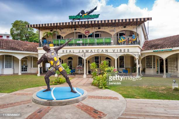 usain bolt's tracks & records restaurant on hip strip in montego bay jamaica - montego bay stock pictures, royalty-free photos & images
