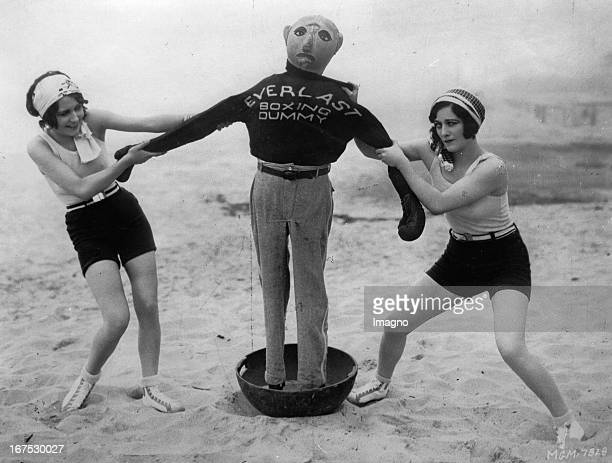 USamerican actress Dorothy Sebastian and Joan Crawford in the Casa de Mar Club / California with a boxing dummy June 19th 1929 Photograph Die...