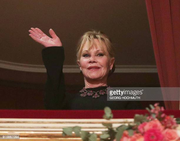 USAmerican actress Melanie Griffith waves prior the opening of the Opera Ball 2018 the sumptuous highlight of the Austrian capital's ball season on...