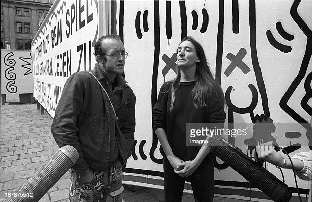USAmerican artists Jenny Holzer and Keith Haring in front of theire installation for the Wiener Festwochen Am Hof Vienna 1986 Photograph by Didi...
