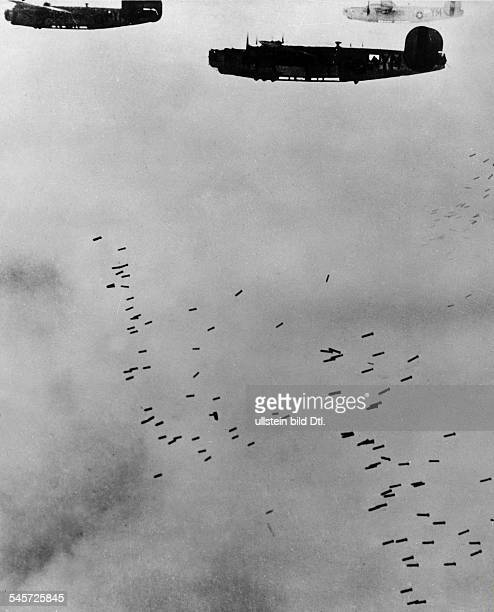 USAmerican B24 bombers during an air raid on Berlin dropping the bombs