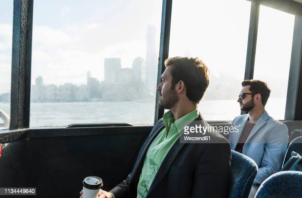 usa,new york city, two businessmen on passenger deck of a ferry - ferry stock pictures, royalty-free photos & images