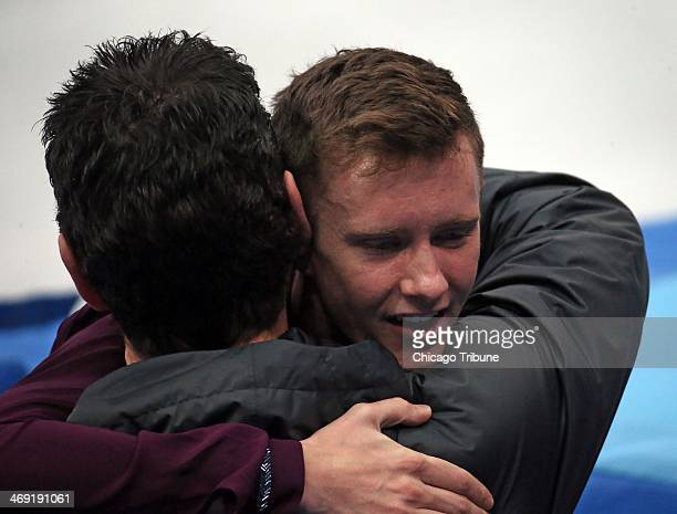 USAs Jeremy Abbott gets a hug after performing during the men's short program figure skating at the Iceberg Skating Palace during the Winter Olympics...