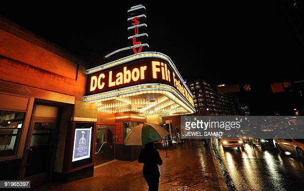 USAsocialcinémaéconomie A man walks past the the AFI Silver theater as it displays poster and messages of the DC Labor FilmFest 2009 in Silver Spring...