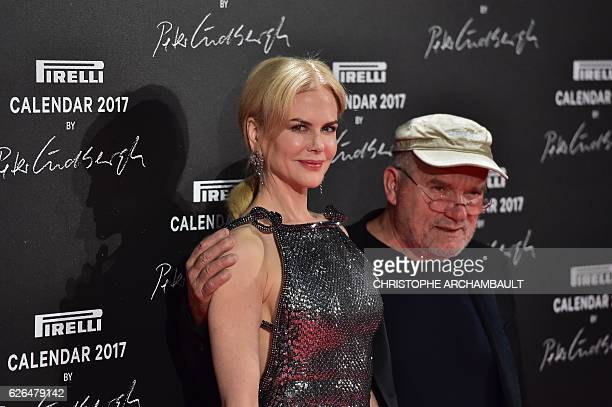 USAustralian actress Nicole Kidman and German photographer Peter Lindbergh pose during a photocall ahead of a gala dinner held for the international...