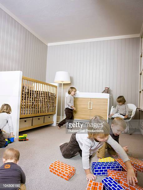 usa,utah,provo,boy (2-3) with baby boy (12-17 months) playing in home - 12 23 months stock pictures, royalty-free photos & images