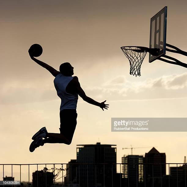 usa,utah,salt lake city,basketball player slam dunking ball - slam dunk stock pictures, royalty-free photos & images