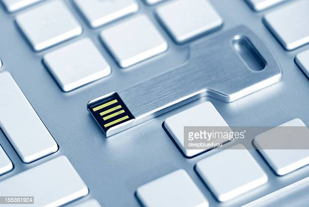 usb key on a blanc computer keyboard - beat your meat stock photos and pictures