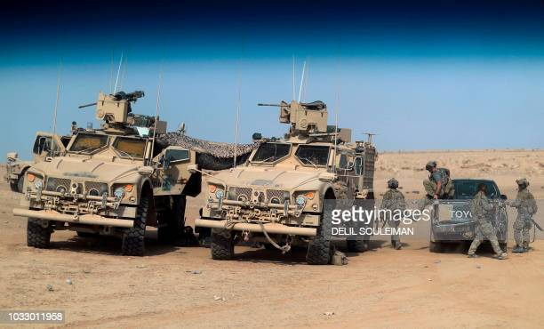 USbacked forces are pictured near the village of Susah in the eastern province of Deir Ezzor near the Syrian border with Iraq on September 13 2018...