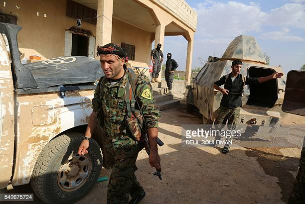 TOPSHOT USbacked Kurdish and Arab fighters advance into the Islamic State jihadist's group bastion of Manbij in northern Syria on June 23 2016 Backed...