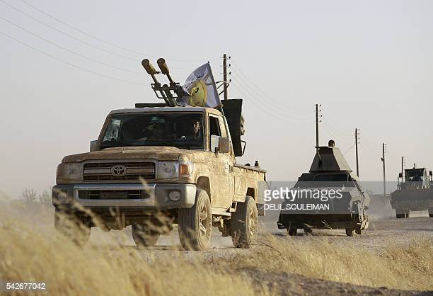 USbacked Kurdish and Arab fighters advance into the Islamic State jihadist's group bastion of Manbij in northern Syria on June 23 2016 Backed by air...
