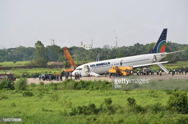 Bangla Boeing 737 aircraft is seen at Chattogram's airport runaway following an emergency landing in Cihttagong on September 26 2018 A USBangla...