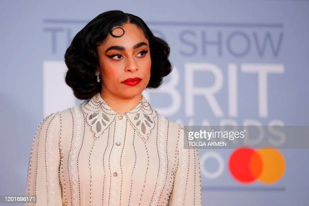 USborn British singer-songwriter Celeste poses on the red carpet on arrival for the BRIT Awards 2020 in London on February 18, 2020. / RESTRICTED TO...