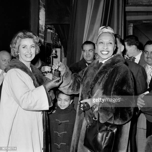 USborn dancer and singer Josephine Baker gives the key of her dressing room to french actress Danielle Darrieux after her last performance at the...