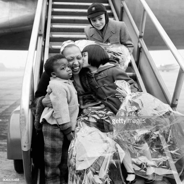 USborn dancer and singer Josephine Baker is welcomed by her children Claude Georges et San on May 19 1956 after a tour at Le Bourget airport / AFP...