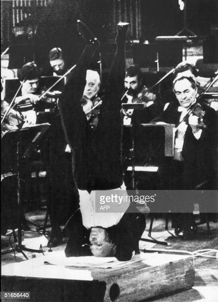 USborn Russian Jewish violinist Yehudi Menuhin one of the most brilliant and celebrated violinists of the century stands on his head in a yoga...