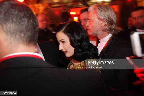 USBurlesque Model Dita von Teese arrives with the host of the evening Hermann Buehlbecker for the Lambertz Monday Night party in Cologne Germany 28...