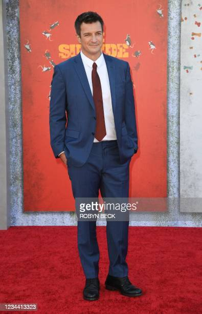 """Canadian actor Nathan Fillion arrives for the premiere of """"The Suicide Squad"""" at the Regency Village theatre in Westwood, California on August 2,..."""