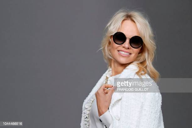 Canadian actress Pamela Anderson poses during a photocall prior to the Chanel SpringSummer 2019 ReadytoWear collection fashion show at the Grand...