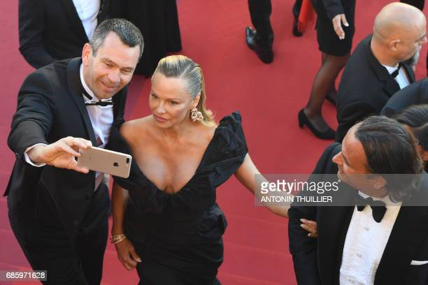 Canadian actress Pamela Anderson poses for selfies as she arrives on May 20, 2017 for the screening of the film '120 Beats Per Minute ' at the 70th...