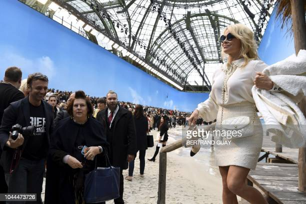 USCanadian actress Pamela Anderson poses on a beach recreated at the Grand Palais prior to the Chanel SpringSummer 2019 ReadytoWear collection...