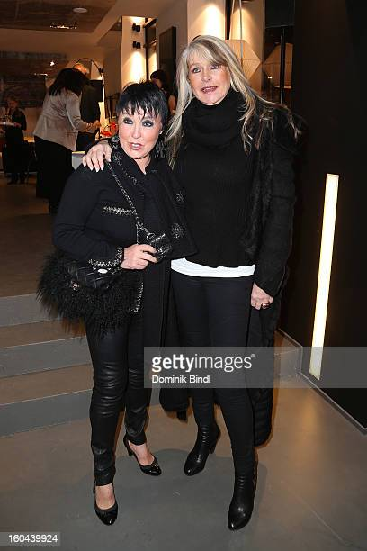 Uschi Ackermann and Claudia Carpendale attend the opening of the Roche Bobois shop on January 31 2013 in Munich Germany