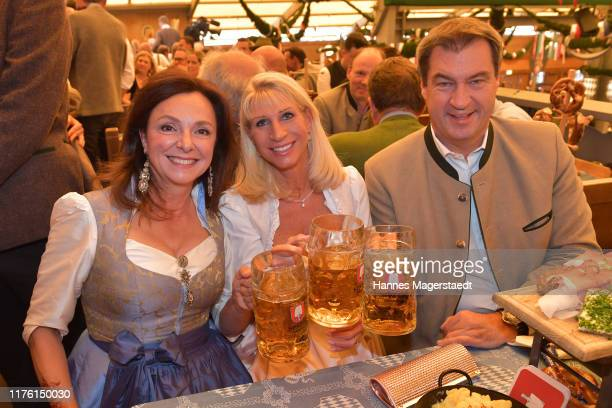 Uschi Daemmrich von Luttitz, Karin Soeder and Markus Soeder during the opening of the 2019 Oktoberfest beer festival at Theresienwiese on September...