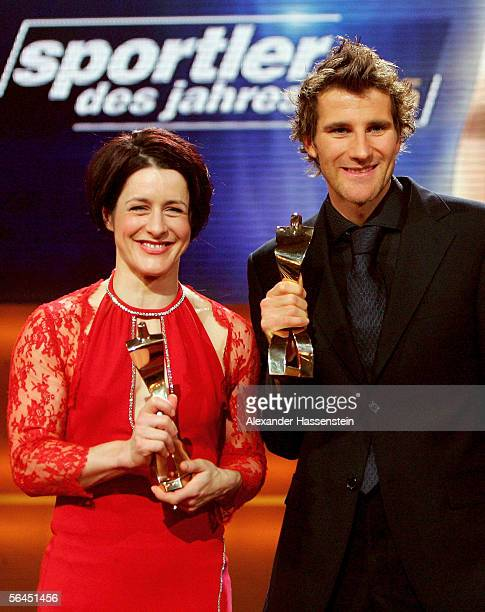Uschi Disl holds her 'Sportswoman of the Year 2005' Award together with Ronny Ackermann winner of the 'Sportsman of the Year 2005' Award during the...