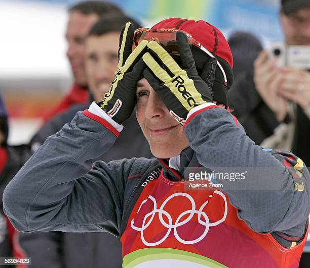Uschi Disl of Germany celebrates winning the Bronze Medal competes in the Womens Biathlon 125km Mass Start Final on Day 15 of the 2006 Turin Winter...