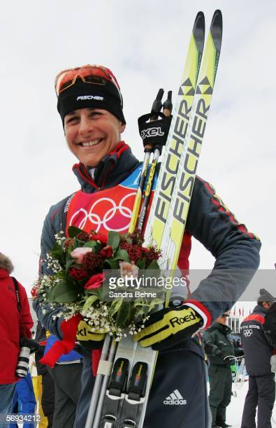 Uschi Disl of Germany celebrates winning the bronze medal in the Womens Biathlon 125km Mass Start Final on Day 15 of the 2006 Turin Winter Olympic...