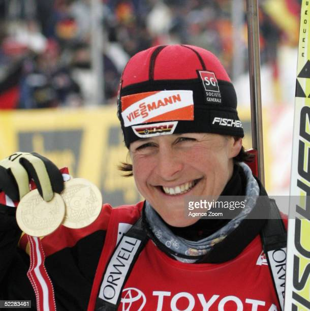 Uschi Disl of Germany celebrates with her two gold medals after the Women's 10km Pursuit in the Biathlon World Cup event March 6, 2005 in Hochfilzen,...