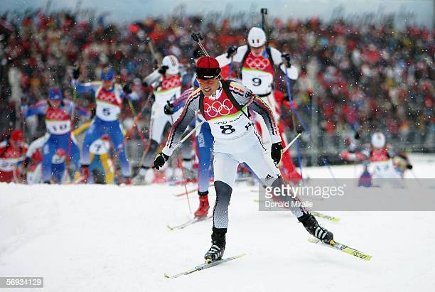 Uschi Disl of Germany leads the pack en route to winning the bronze medal in the Womens Biathlon 125km Mass Start Final on Day 15 of the 2006 Turin...