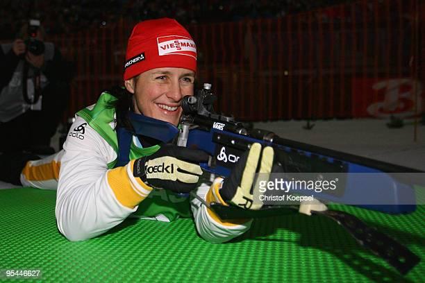 Uschi Disl shoots during the prominent race during the ODLO Biathlon World Team Challenge at the Veltins Arena on December 28 2009 in Gelsenkirchen...