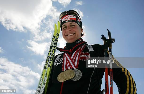 Uschi Disl shows off her medals at the 2005 Biathlon World Championship in Hochfilzen, Austria. March 6, 2005.