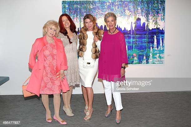 Uschi Gahren Eva Schnitzenbaumer Mariete Lautner Carmen Hirmer attend the Mauro Bergonzoli Exhibition 'Selected Works' at Hubert Burda Media...