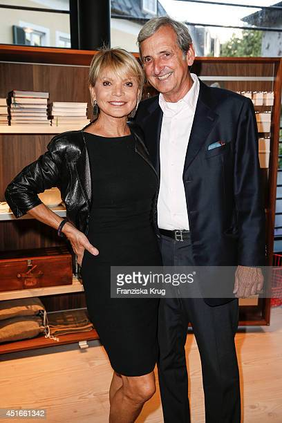 Uschi Glas and Dieter Hermann attend the Bulthaup Showroom Opening on July 03 2014 in Munich Germany
