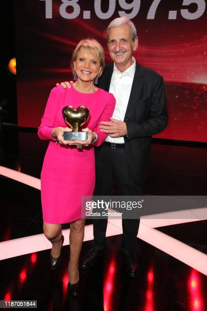 Uschi Glas with award golden heart and her husband Dieter Hermann during the Ein Herz Fuer Kinder Gala show at Studio Berlin Adlershof on December 7...