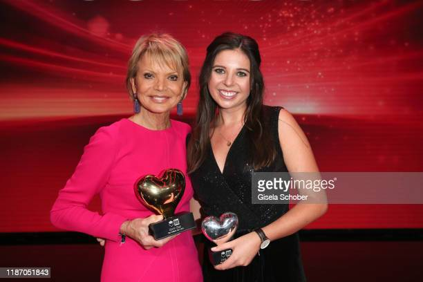 """Uschi Glas with award """"golden heart"""" and Lena Palm during the Ein Herz Fuer Kinder Gala show at Studio Berlin Adlershof on December 7, 2019 in..."""