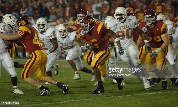 USCs Reggie Bush trys to find a hole in Texas defense during the USC Trojans game versus Texas Longhorns in the Rose bowl game and BCS National...