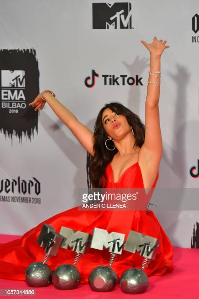 USCuban singer Camila Cabello poses with her four awards backstage during the MTV Europe Music Awards at the Bizkaia Arena in the northern Spanish...