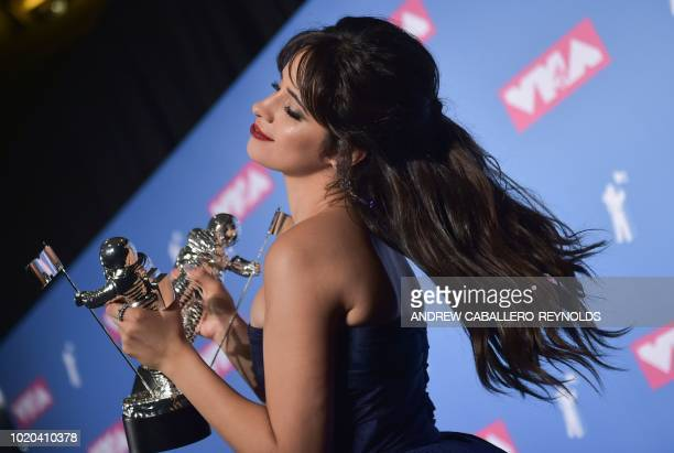 US/Cuban singer/songwriter Camila Cabello holds her 2 awards for Video of the Year and Artist of the Year in the press room at the 2018 MTV Video...