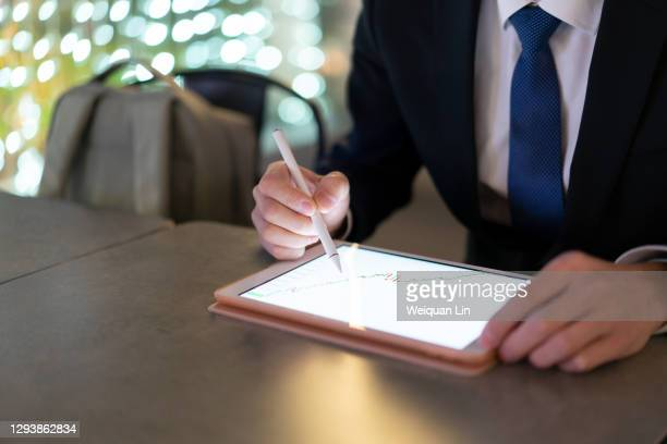 use a capacitive pen on a tablet - fujian province stock pictures, royalty-free photos & images