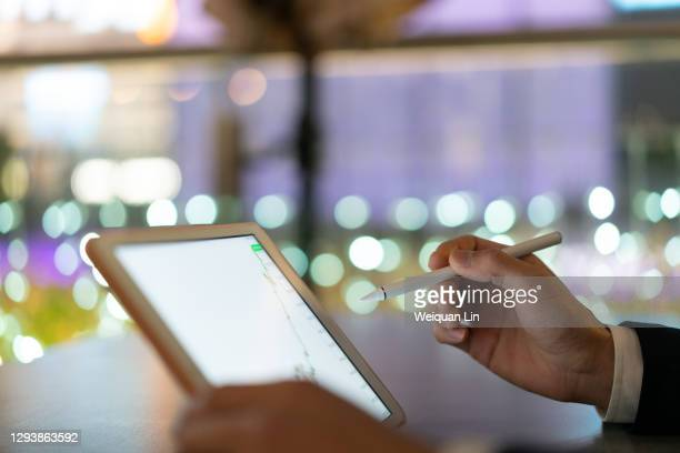 use a capacitive pen on a tablet - signing stock pictures, royalty-free photos & images