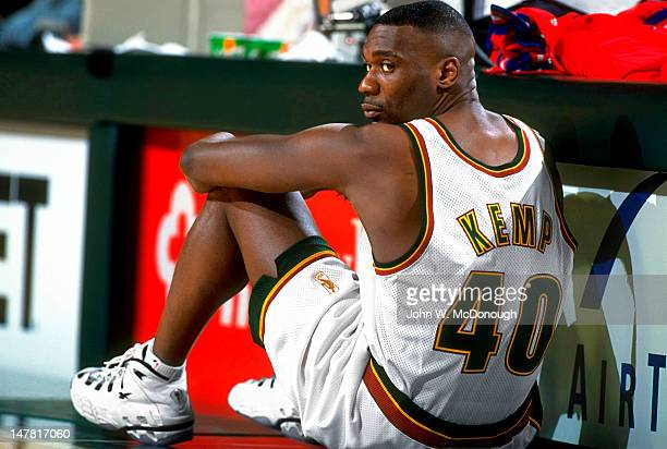 Seattle SuperSonics Shawn Kemp sitting beside scorer's table during game vs Milwaukee Bucks at Key Arena Seattle WA CREDIT John W McDonough