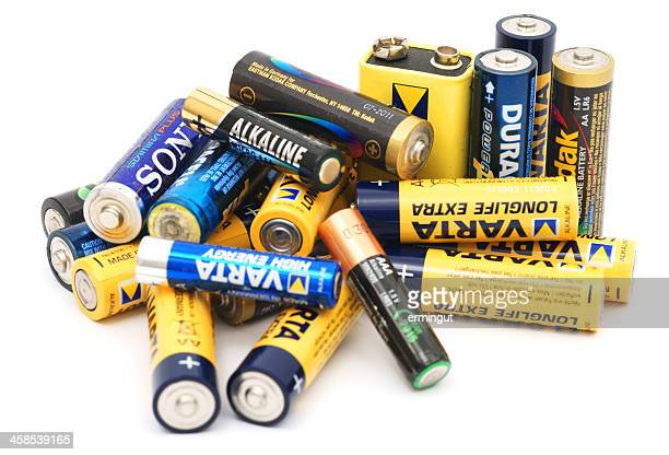 Used batteries pile isolated on white